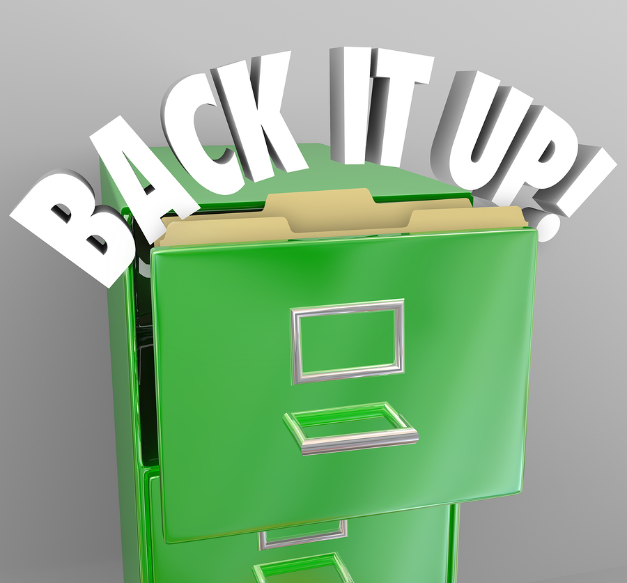 The words Back It Up in a filing cabinet to communicate a messag